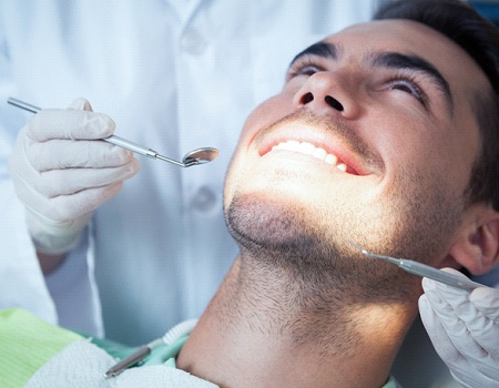 Man getting a dental cleaning