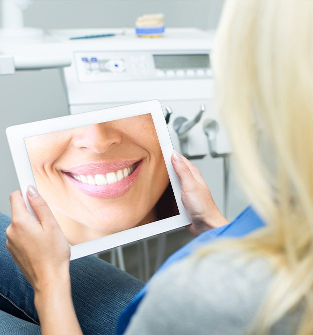 Woman looking at smile tablet computer
