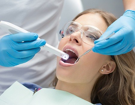 Woman having intraoral images taken