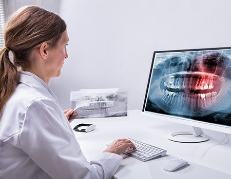 Dentist looking at dental x-rays