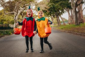 two children trick-or-treating