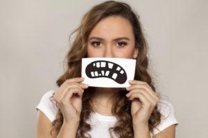 Unhappy woman with harmful dental habits
