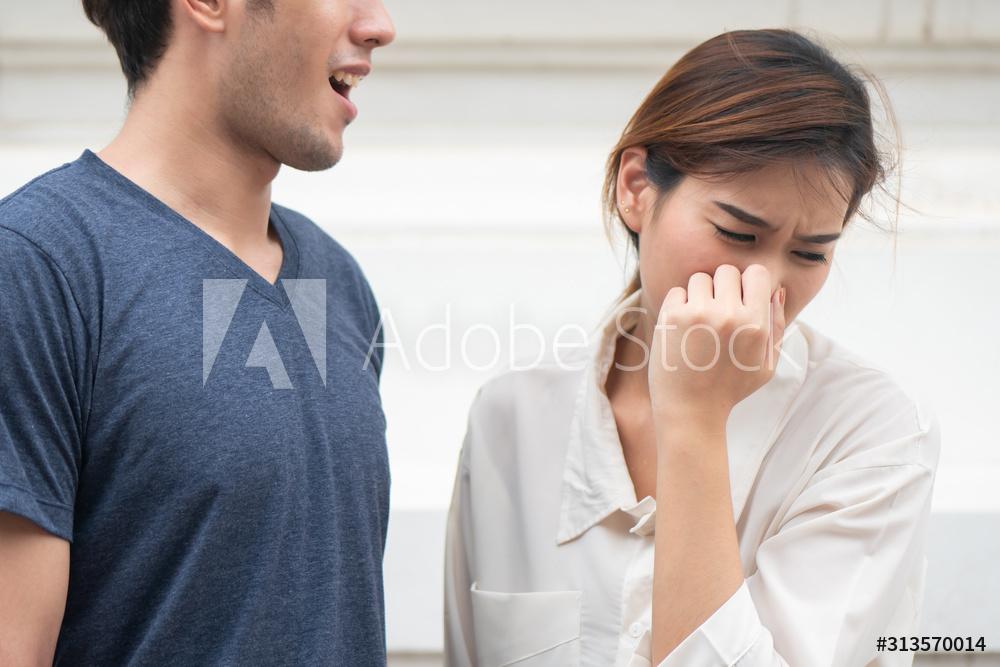 Woman smells bad breath